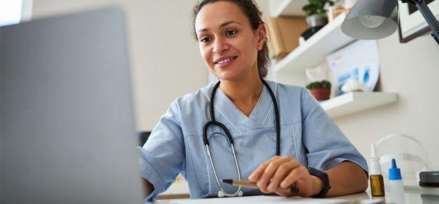 Medical Professional looking at computer screen