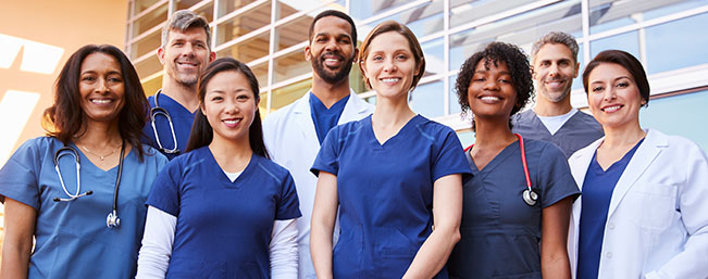 Medical professionals standing in front of office building