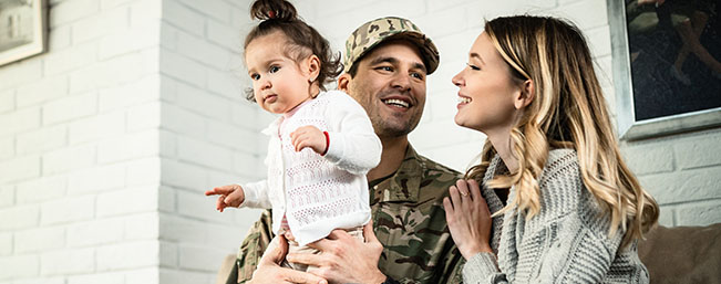 Miltary couple holding baby girl